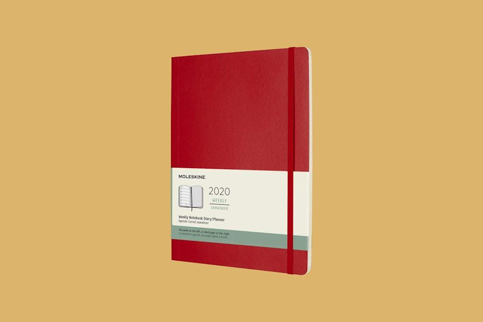 """<p>Take things week by week in this signature moleskin planner. Lightweight and easy to tote around, it's a great way to keep track of everything on the school calendar.</p> <p><strong><em>Shop Now:</em></strong><em> Moleskin Classic 12 Month Weekly Planner in Scarlet Red, 7.5'' by 9.5'', $20.09, <a href=""""https://www.amazon.com/dp/B07JVF73SG/ref=as_li_ss_tl?ie=UTF8&linkCode=ll1&tag=msllifeplannersforbacktoschoolegoldman0720-20&linkId=c4d423f3caf66c7022c191939a3e6151&language=en_US"""" rel=""""nofollow noopener"""" target=""""_blank"""" data-ylk=""""slk:amazon.com"""" class=""""link rapid-noclick-resp"""">amazon.com</a>.</em></p>"""