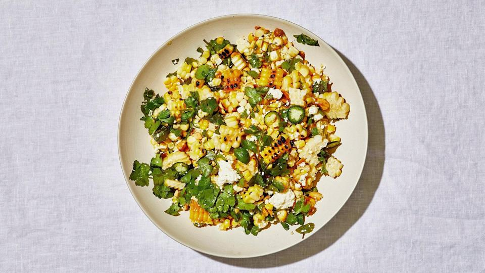 "Sweet summer corn begs to be mixed with a splash of acid, a touch of heat, salty cheese, and toasty nuts for texture. This recipe is definitely a choose-your-own-adventure. Use whatever you like or have on hand! <a href=""https://www.bonappetit.com/recipe/no-brainer-corn-salad?mbid=synd_yahoo_rss"" rel=""nofollow noopener"" target=""_blank"" data-ylk=""slk:See recipe."" class=""link rapid-noclick-resp"">See recipe.</a>"