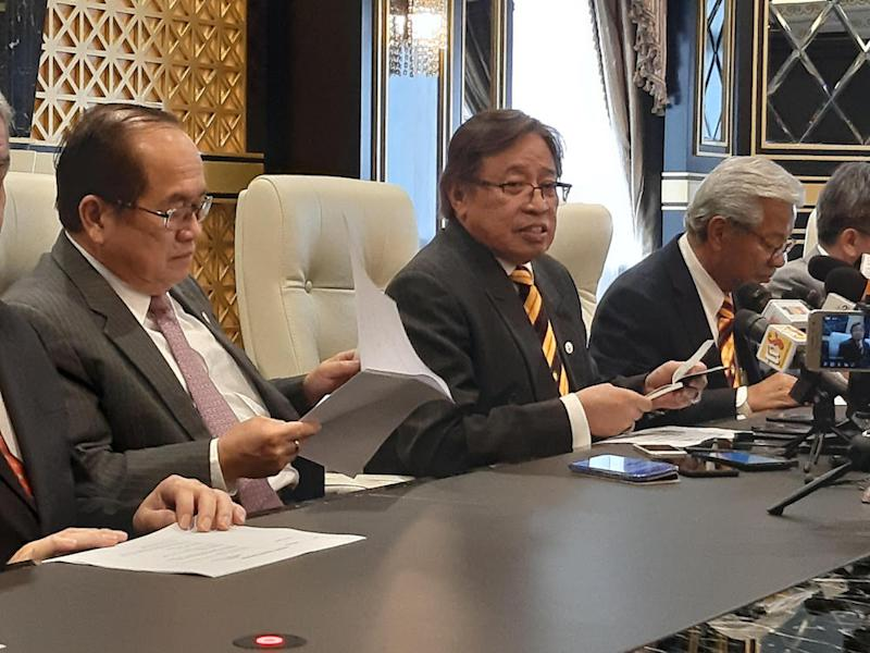 Chief Minister Datuk Patinggi Abang Johari Openg (centre) speaks to reporters after chairing a state Cabinet meeting in Kuching August 22, 2019. — Picture by Sulok Tawie