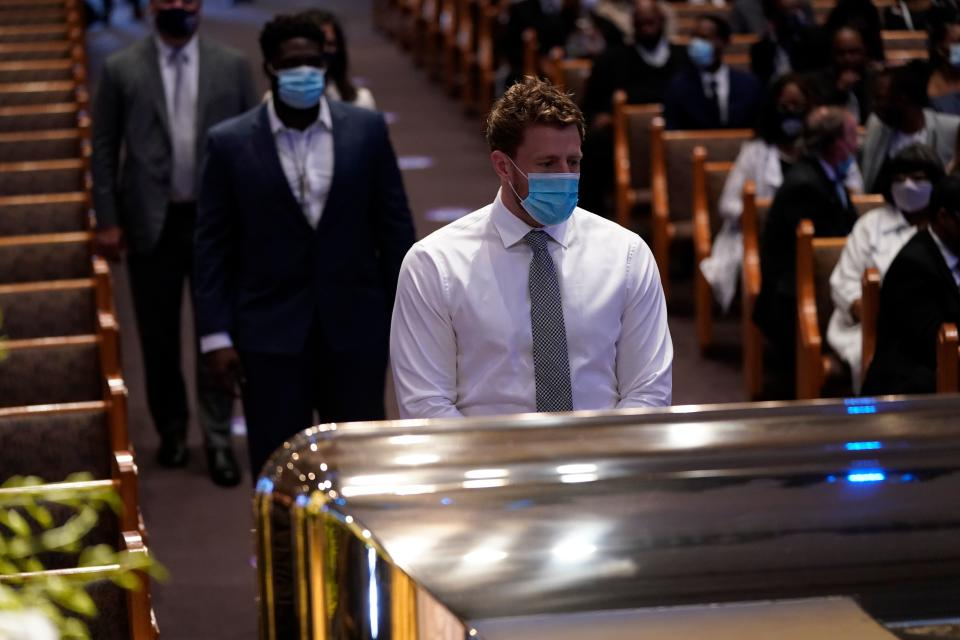 Houston Texans NFL player J.J. Watt, pauses by the casket of George Floyd  on June 9, 2020, at The Fountain of Praise church in Houston, Texas. - George Floyd will be laid to rest Tuesday in his Houston hometown, the culmination of a long farewell to the 46-year-old African American whose death in custody ignited global protests against police brutality and racism. Thousands of well-wishers filed past Floyd's coffin in a public viewing a day earlier, as a court set bail at $1 million for the white officer charged with his murder last month in Minneapolis. (Photo by David J. Phillip / POOL / AFP) (Photo by DAVID J. PHILLIP/POOL/AFP via Getty Images)