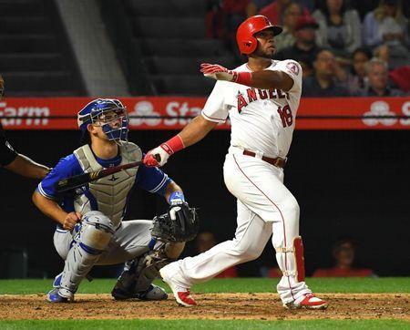 Jun 21, 2018; Anaheim, CA, USA; Toronto Blue Jays catcher Luke Maile (21) looks on as Los Angeles Angels third baseman Luis Valbuena (18) hits his second home run of the game in the seventh inning at Angel Stadium of Anaheim. Mandatory Credit: Jayne Kamin-Oncea-USA TODAY Sports
