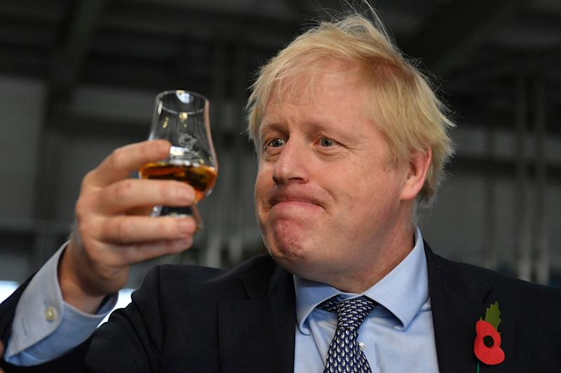 Prime Minister Boris Johnson tastes whisky during a general election campaign visit to Diageo's Roseisle Distillery near Elgin: AP