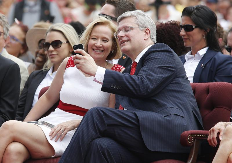 Canada's Prime Minister Stephen Harper takes a 'selfie' with his wife Laureen during Canada Day celebrations in Ottawa