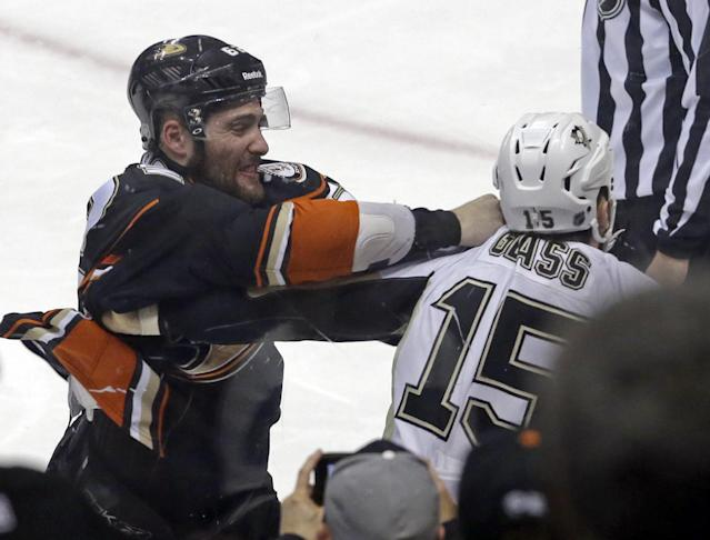 Anaheim Ducks left winger Patrick Maroon (62) and Pittsburgh Penguins left winger Tanner Glass (15) fight, drawing each a five-minute penalty, in the first period of an NHL hockey game in Anaheim, Calif., Friday, March 7, 2014. (AP Photo/Reed Saxon)