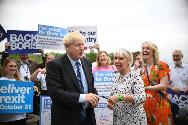 Conservative Party leadership candidate Boris Johnson with Nadine Dorries (centre) and Chief Secretary to the Treasury Liz Truss (right) during a Tory leadership hustings at the Woodlands Event Centre in Wyboston, Bedfordshire. Source: Joe Giddens/PA Images via Getty Images