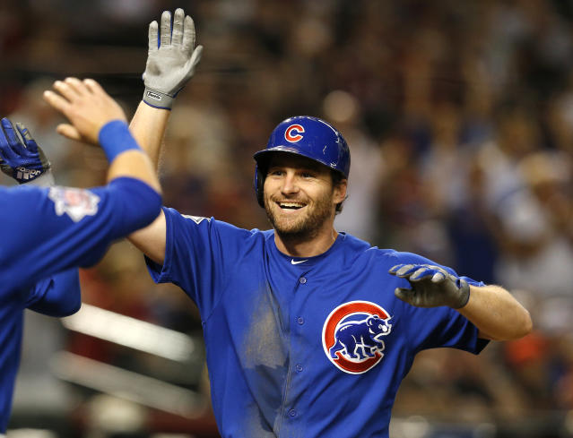 FILE - In this Sept. 18, 2018, file photo, Chicago Cubs second baseman Daniel Murphy is congratulated during the team's baseball game against the Arizona Diamondbacks in Phoenix. The Colorado Rockies have brought in Murphy to boost an offense big on pop but lackluster in batting average. The veteran infielder has agreed to a $24 million, two-year contract with the Rockies, a person familiar with the negotiations told The Associated Press on Thursday night, Dec. 20. The person spoke on condition of anonymity because the deal was subject to a successful physical. (AP Photo/Rick Scuteri, File)