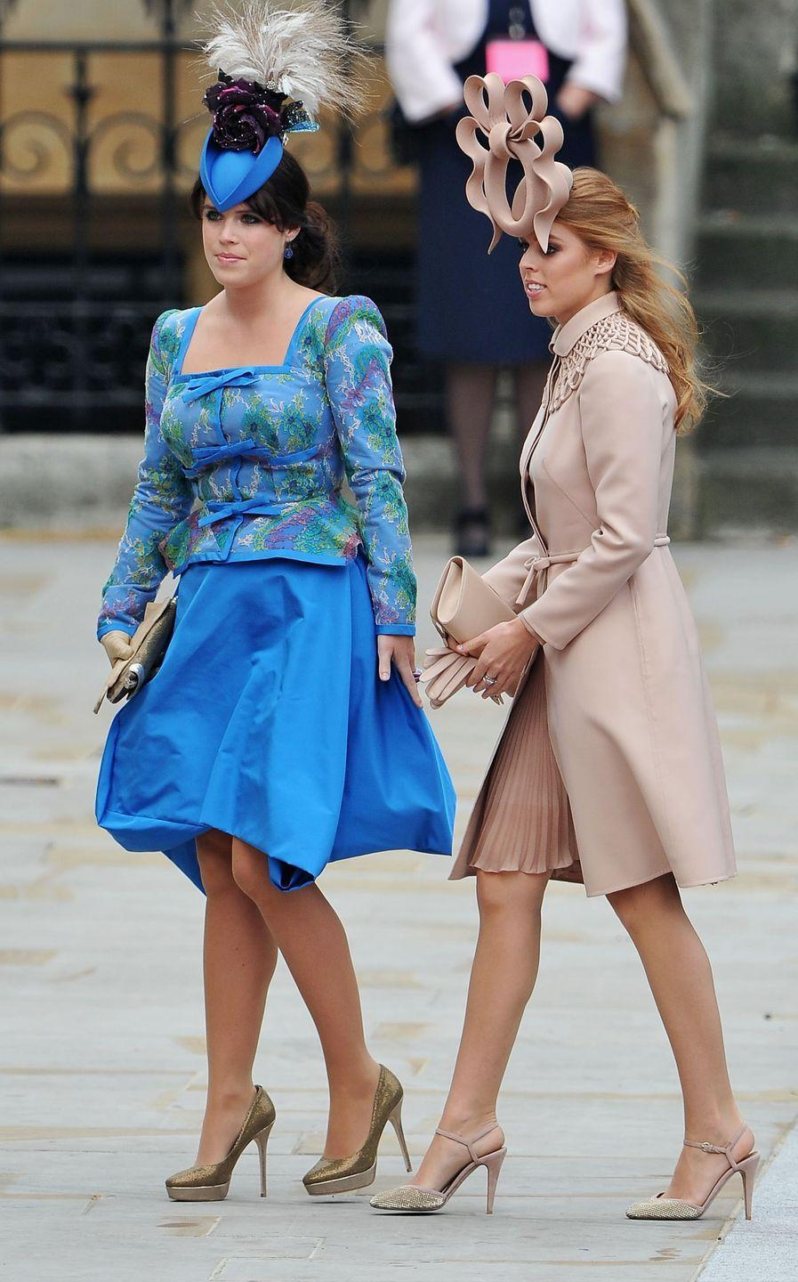 "<p>When sisters Princess Eugenie and Princess Beatrice arrived at Prince William and Kate's 2011 wedding, <a href=""https://www.townandcountrymag.com/style/fashion-trends/g15896831/princess-beatrice-best-hats/"" rel=""nofollow noopener"" target=""_blank"" data-ylk=""slk:it was a hat moment heard 'round the world."" class=""link rapid-noclick-resp"">it was a hat moment heard 'round the world.</a><br></p>"