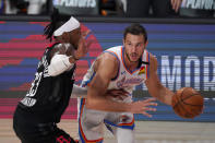Houston Rockets' Robert Covington (33) defends as Oklahoma City Thunder's Danilo Gallinari (8) handles the ball during the second half of an NBA first-round playoff basketball game in Lake Buena Vista, Fla., Wednesday, Sept. 2, 2020. (AP Photo/Mark J. Terrill)