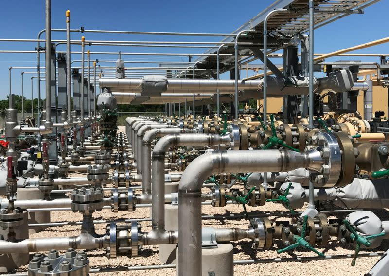 FILE PHOTO: Equipment used to process carbon dioxide, crude oil and water is seen at an Occidental Petroleum Corp enhanced oil recovery project in Hobbs