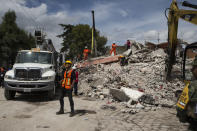 <p>A volunteer stands next to a search and rescue operation at a building felled by a 7.1-magnitude earthquake in San Gregorio Atlapulco, Mexico, Friday, Sept. 22, 2017. Mexican officials are promising to keep up the search for survivors as rescue operations stretch into a fourth day following Tuesday's major earthquake that devastated Mexico City and nearby states. (AP Photo/Moises Castillo) </p>