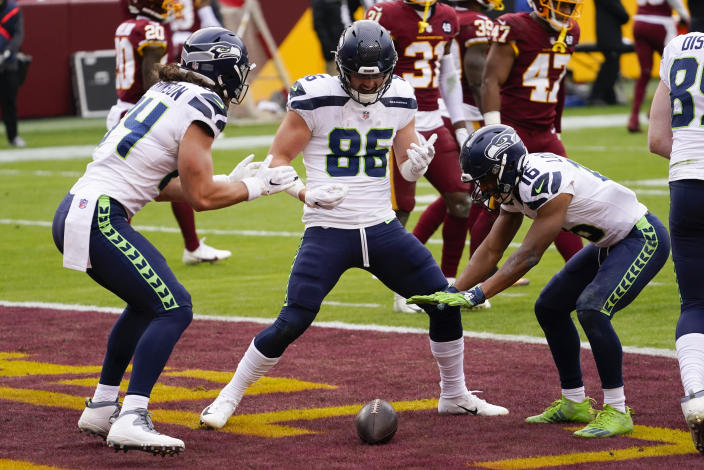Seattle Seahawks tight end Jacob Hollister (86) celebrating his touchdown with teammates tight end Colby Parkinson (84) and wide receiver Tyler Lockett (16) during the first half of an NFL football game against the Washington Football Team, Sunday, Dec. 20, 2020, in Landover, Md. (AP Photo/Andrew Harnik)