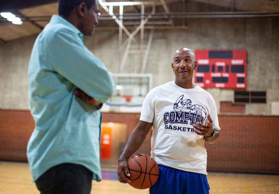 "Compton High Coach Tony Thomas, right, and L.A. City Wildcats director Derrick Cooper recount their time spent with Semaj Miller. <span class=""copyright"">(Jason Armond / Los Angeles Times)</span>"