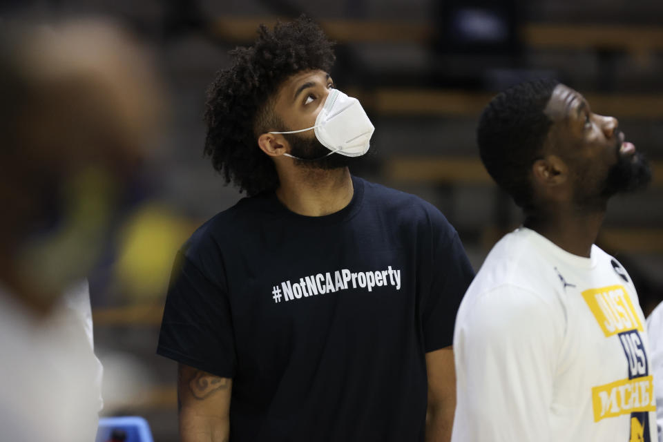 WEST LAFAYETTE, INDIANA - MARCH 20: In a t-shirt and walking boot, Isaiah Livers #2 of the Michigan Wolverines looks on prior to the game against the Texas Southern Tigers in the first round game of the 2021 NCAA Men's Basketball Tournament at Mackey Arena on March 20, 2021 in West Lafayette, Indiana. (Photo by Gregory Shamus/Getty Images)