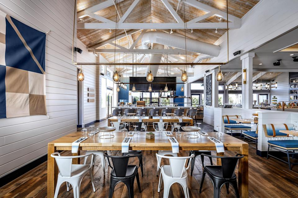 "<p><strong>Tell us about your first impressions when you arrived.</strong><br> This tucked-away restaurant, far from downtown Monterey, has become one of the town's most notable. High ceilings and lots of natural light make it modern, while playful art and sculpture made from wood and with Pacific blue hues celebrate the region's maritime history.</p> <p><strong>What was the crowd like?</strong><br> Though this is technically a hotel restaurant (it's located at the <a href=""https://www.cntraveler.com/hotels/united-states/marina/sanctuary-beach-resort-monterey-bay?mbid=synd_yahoo_rss"" rel=""nofollow noopener"" target=""_blank"" data-ylk=""slk:Sanctuary Beach Resort"" class=""link rapid-noclick-resp"">Sanctuary Beach Resort</a>), you'll find mostly locals and regulars filling the tables and bar seats. It all makes for a relaxed and buzzy atmosphere, and patrons are dressed in their best casual attire.</p> <p><strong>What should we be drinking?</strong><br> Classic cocktails (Pimm's cups, gin fizzs, Manhattans) keep the ordering straightforward and simple. But even if they're standards, the bartenders take them seriously, making them well-balanced and served at the perfect temperature.</p> <p><strong>Main event: the food. Give us the lowdown—especially what not to miss.</strong><br> Monterey is home to some of the best seafood in the country, but many area restaurants compromise it for the tourist hustle. Salt Wood doesn't. Starters like grilled Monterey Bay sardines need only the fennel and citrus they're served with, and local oysters grilled with kimchi butter, bernaise, and tarragon pesto are a must. For entrees, the popular vote goes to the fried chicken and biscuits.</p> <p><strong>And how did the front-of-house folks treat you?</strong><br> The staff is friendly, informative, and quick to make recommendations tailored to your preferences.</p> <p><strong>What's the real-real on why we're coming here?</strong><br> Come for a quick bite, or a leisurely post-sunset dinner.</p>"