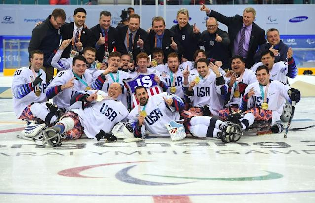 US players celebrate their victory in the ice hockey gold medal game (AFP Photo/Jung Yeon-je)