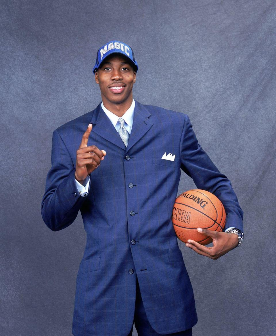 """<p>Dwight Howard was just 18 years old when he entered the NBA, which means he was still going through some teen stuff. When he was drafted first overall in 2004 by the Orlando Magic, he still had a <a href=""""https://www.espn.com/blog/playbook/visuals/post/_/id/5113/flashback-dwight-howard-wearing-braces"""" rel=""""nofollow noopener"""" target=""""_blank"""" data-ylk=""""slk:mouth full of metal"""" class=""""link rapid-noclick-resp"""">mouth full of metal</a>. He got the braces removed before preseason, though.</p>"""