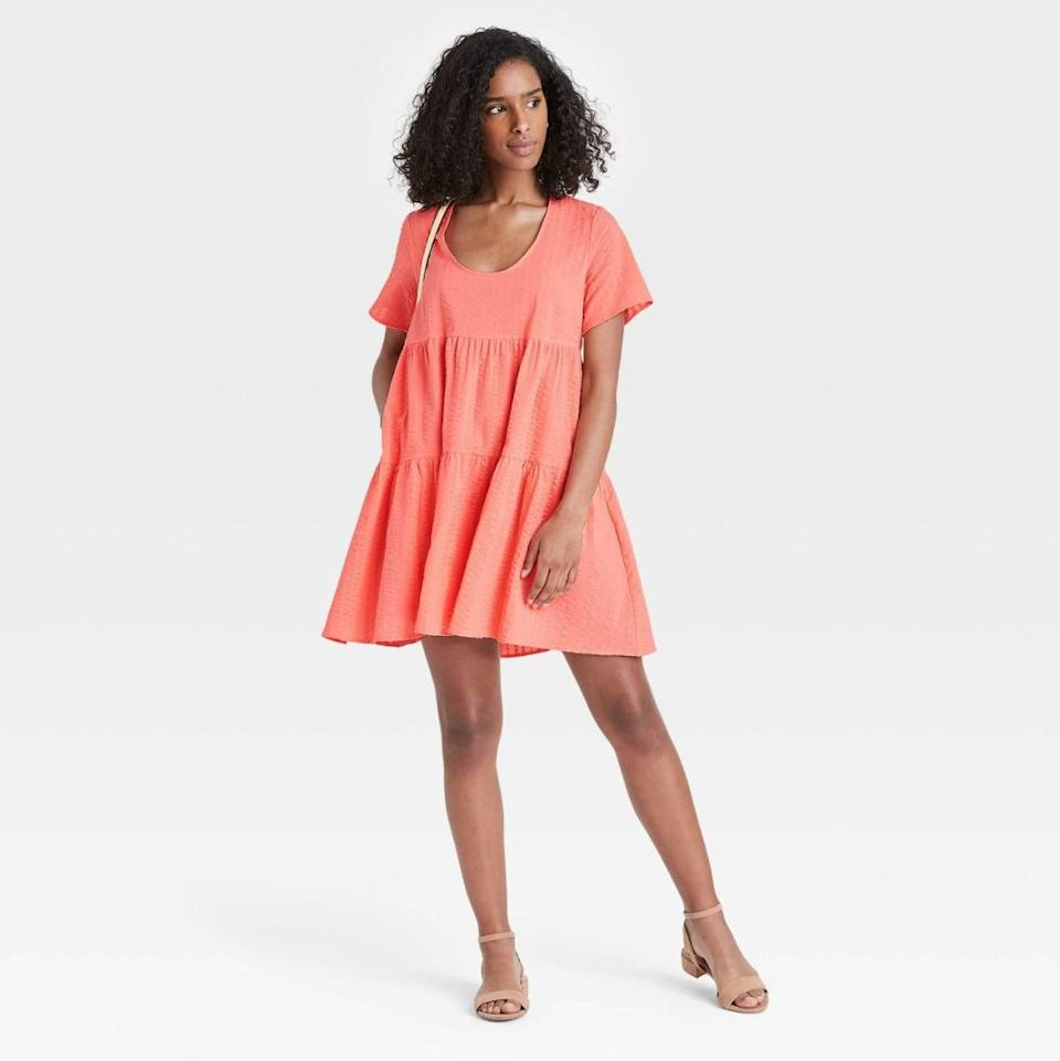 <p>I have the <span>A New Day Flutter Short Sleeve Tiered Dress in Peach</span> ($25) and love the pop of color. It looks perfect with sneakers and sandals.</p>