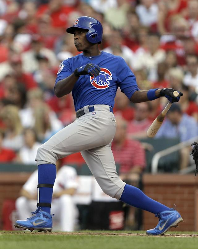 Chicago Cubs' Alfonso Soriano hits an RBI-double during the first inning of a baseball game against the St. Louis Cardinals on Tuesday, June 18, 2013, in St. Louis. (AP Photo/Jeff Roberson)