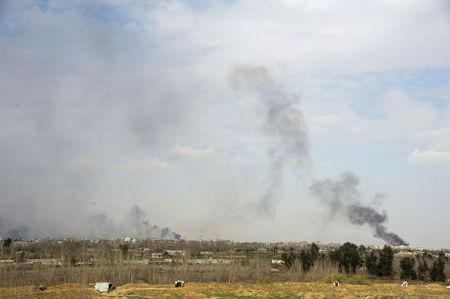 Smoke rises from eastern Ghouta in Damascus