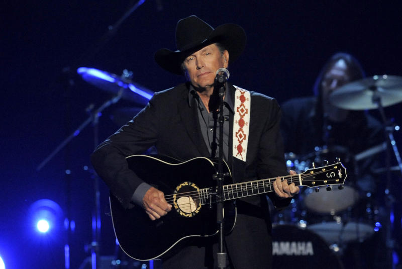 FILE - This April 7, 2013 file photo shows George Strait performing at the 48th Annual Academy of Country Music Awards at the MGM Grand Garden Arena in Las Vegas. Strait will finish off his two-year farewell tour in the biggest house in his home state of Texas _ the Dallas Cowboys' AT&T Stadium. The country superstar held a rare news conference Monday, Sept. 9, at the stadium to announce the last leg of his The Cowboy Rides Away tour. He announced he was retiring from the road last year, but still plans to record, recently agreeing to a deal for five more studio albums. (Photo by Chris Pizzello/Invision/AP, File)