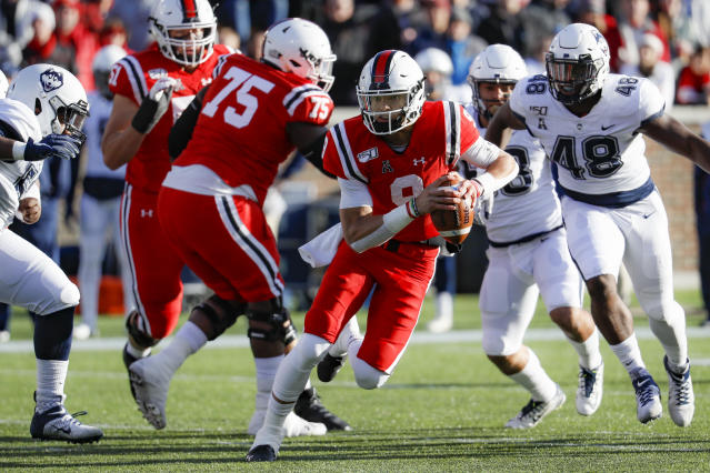 Cincinnati quarterback Desmond Ridder (9) runs the ball during the first half of an NCAA college football game against Connecticut, Saturday, Nov. 9, 2019, in Cincinnati. (AP Photo/John Minchillo)