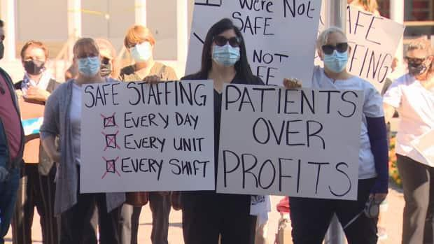 Nurses protested at the legislature in Fredericton on Friday. Nurses and other healthcare workers represented by the union have been without a contract since Dec. 31, 2018.   (Ed Hunter - image credit)