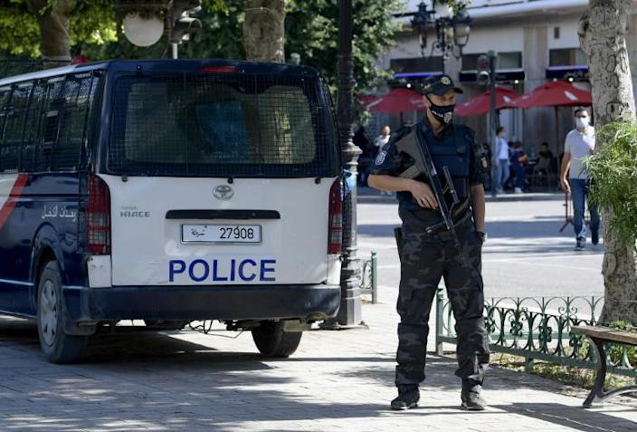 A Tunisian security officer stands guard in the capital Tunis in October; experts warn that efforts to stem recruitment of young Tunisians by extremists too often focuses on security alone, without tackling the root causes