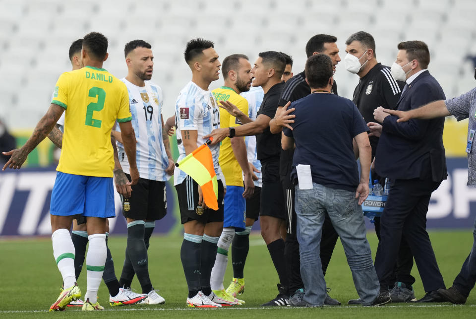 Brazil and Argentina's player talk as the soccer game is interrupted by health authorities during a qualifying soccer match for the FIFA World Cup Qatar 2022 at Neo Quimica Arena stadium in Sao Paulo, Brazil, Sunday, Sept.5, 2021. (AP Photo/Andre Penner)