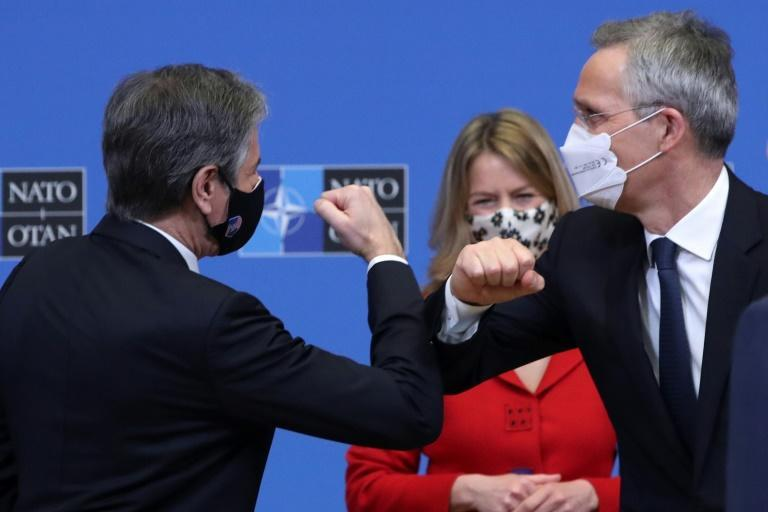 US Secretary of State Antony Blinken bumps elbows with NATO chief Jens Stoltenberg