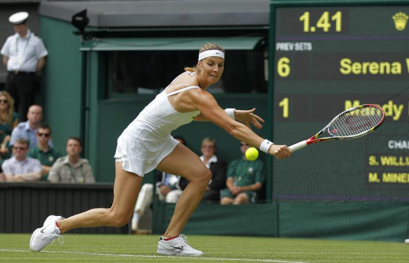 Mandy Minella of Luxembourg returns the ball to Serena Williams of the United States during their Women's first round singles match at the All England Lawn Tennis Championships in Wimbledon, London, Tuesday, June 25, 2013. (AP Photo/Sang Tan)
