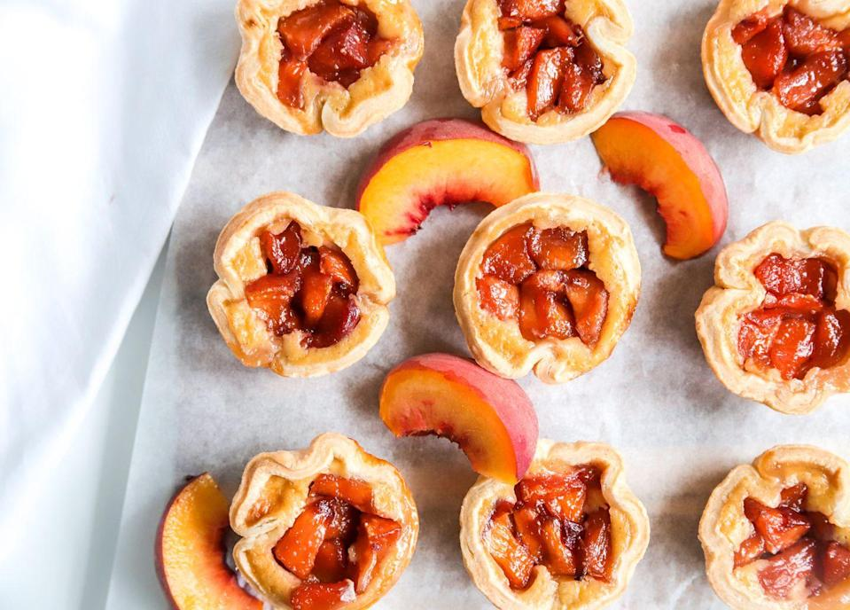 """<p>What's better than a regular pie? A bunch of miniature ones, of course. </p><p><strong>Get the recipe at <a href=""""https://bakesbybrownsugar.com/peach-custard-mini-pies/"""" rel=""""nofollow noopener"""" target=""""_blank"""" data-ylk=""""slk:Bakes by Brown Sugar"""" class=""""link rapid-noclick-resp"""">Bakes by Brown Sugar</a>.</strong></p><p><a class=""""link rapid-noclick-resp"""" href=""""https://go.redirectingat.com?id=74968X1596630&url=https%3A%2F%2Fwww.walmart.com%2Fsearch%2F%3Fquery%3Dpioneer%2Bwoman%2Bbaking%2Bpan&sref=https%3A%2F%2Fwww.thepioneerwoman.com%2Ffood-cooking%2Frecipes%2Fg36382592%2Fpeach-desserts%2F"""" rel=""""nofollow noopener"""" target=""""_blank"""" data-ylk=""""slk:SHOP BAKING PANS"""">SHOP BAKING PANS</a></p>"""
