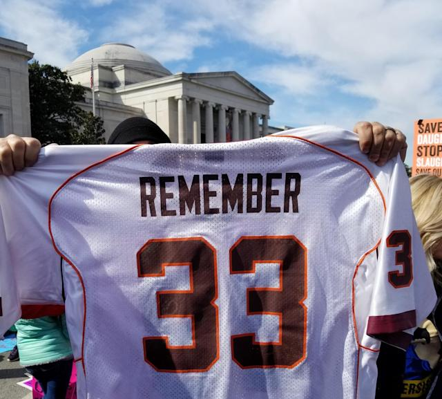 Tucker Foreman holds up his custom jersey in honor of those who died in the 2007 mass shooting at Virginia Tech. (Christopher Wilson/Yahoo News)