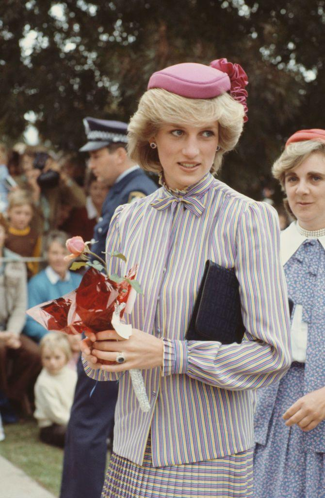 <p>While visiting St Paul's Church in Australia, Princess Diana wore a lavender striped outfit paired with a bubblegum pink pillbox hat by John Boyd. </p>