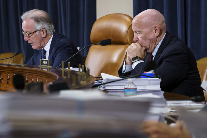 FILE - In this Sept. 14, 2021, file photo House Ways and Means Committee Chairman Richard Neal, D-Mass., left, and Rep. Kevin Brady, R-Texas, the ranking member, right, make opening statements as the tax-writing panel continues work on the Democrats' proposal for tax hikes on big corporations and the wealthy to fund President Joe Biden's $3.5 trillion domestic rebuilding plan, at the Capitol in Washington. (AP Photo/J. Scott Applewhite, File)