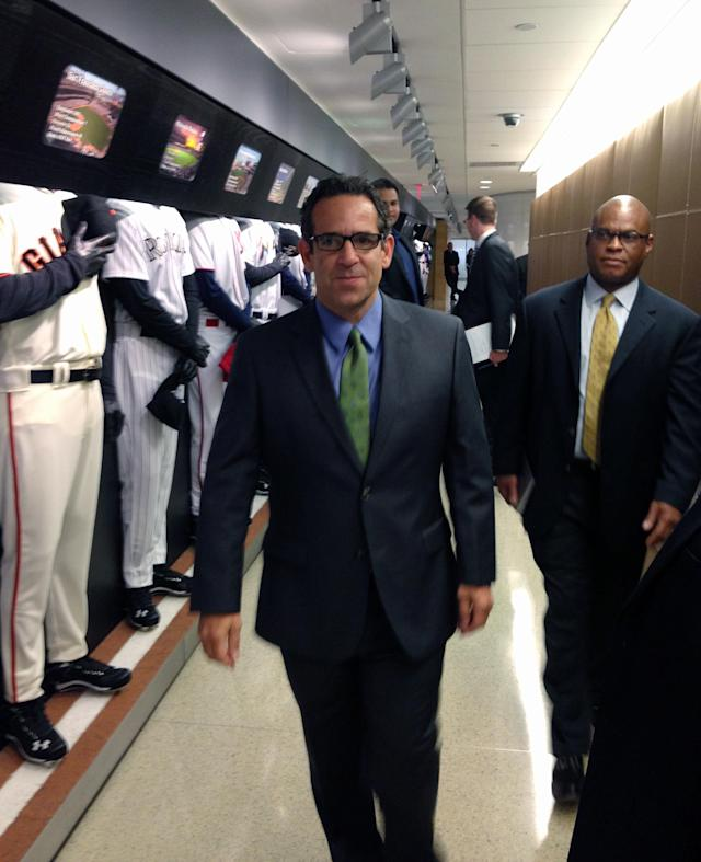 FILE - In this Sept. 30, 2013, file photo provided by Fitzpatrick Communications, Anthony Bosch is escorted by Major League Baseball security person Ric Burnham, right, at MLB headquarters in New York. Federal authorities are charging the owner of a defunct Florida clinic accused of providing steroids and other banned substances to Major League Baseball players, including New York Yankees star Alex Rodriguez. According to Miami federal court records Tuesday, Aug. 5, 2014, Anthony Bosch faced one count of conspiracy to distribute testosterone. (AP Photo/Fitzpatrick Communications)