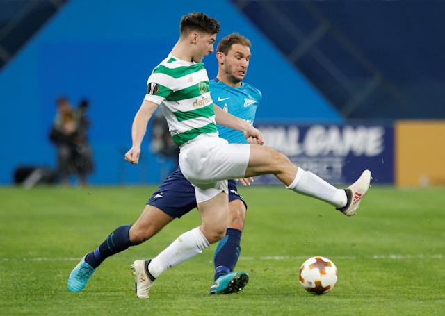Soccer Football - Europa League Round of 32 Second Leg - Zenit Saint Petersburg vs Celtic - Stadium St. Petersburg, Saint Petersburg, Russia - February 22, 2018 Celtic's Kieran Tierney in action with Zenit St. Petersburg's Branislav Ivanovic REUTERS/Anton Vaganov