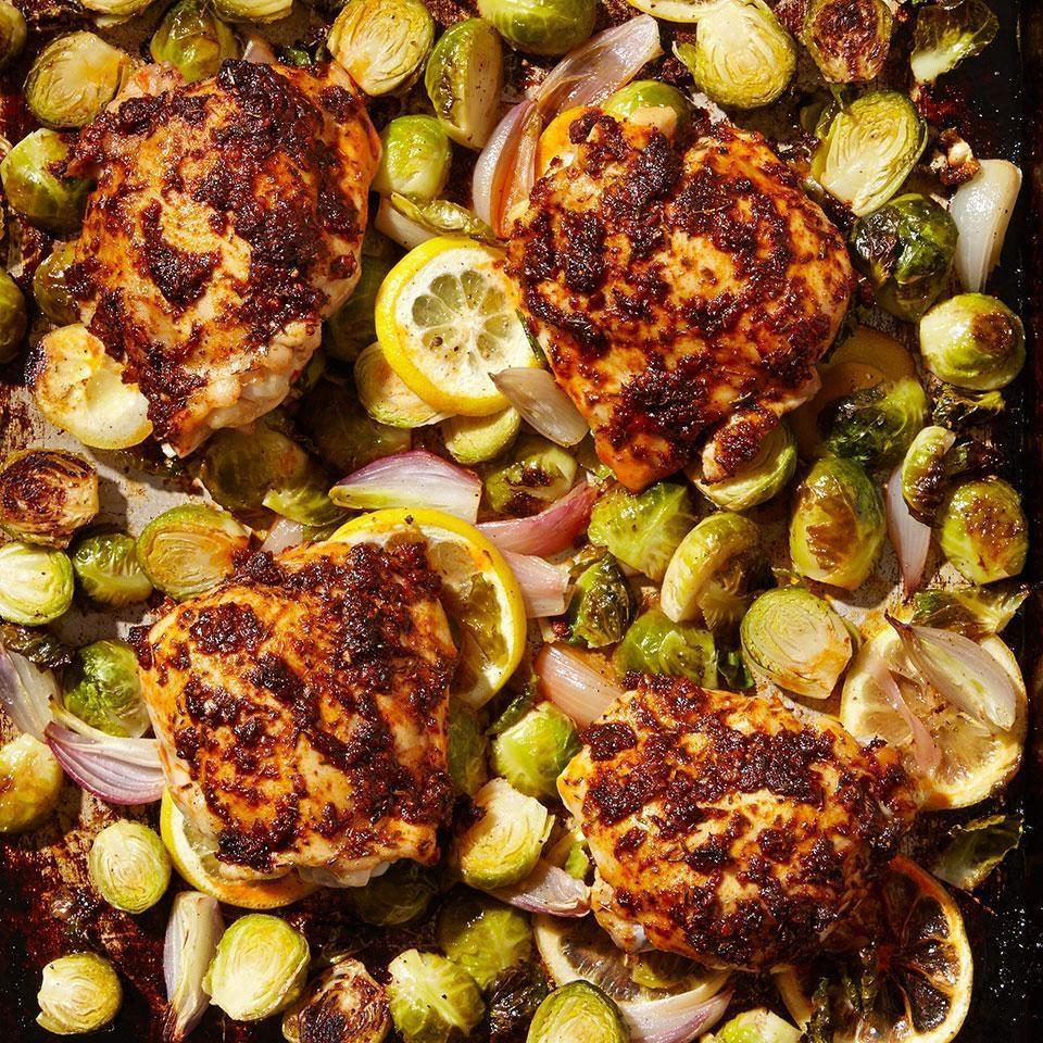 <p>In this healthy chicken recipe, paprika-rubbed chicken thighs are nestled into Brussels sprouts and shallots and roasted on a sheet pan in the oven for an easy, healthy dinner. As the chicken thighs roast, the garlicky drippings flavor the Brussels sprouts and shallots. Delicious one-pan cooking! Smoked paprika adds a touch of smoky flavor--look for it at well-stocked supermarkets or in the bulk-spice section at natural-foods markets. Regular paprika can be used in its place, but doesn't add the hint of smoke.</p>