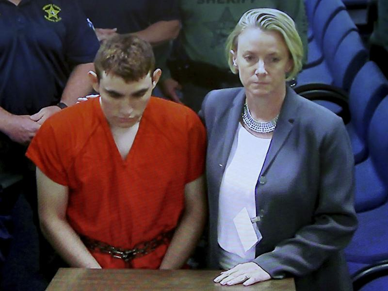 A video monitor shows school shooting suspect Nikolas Cruz making an appearance in Broward County Court: Susan Stocker/South Florida Sun-Sentinel via AP