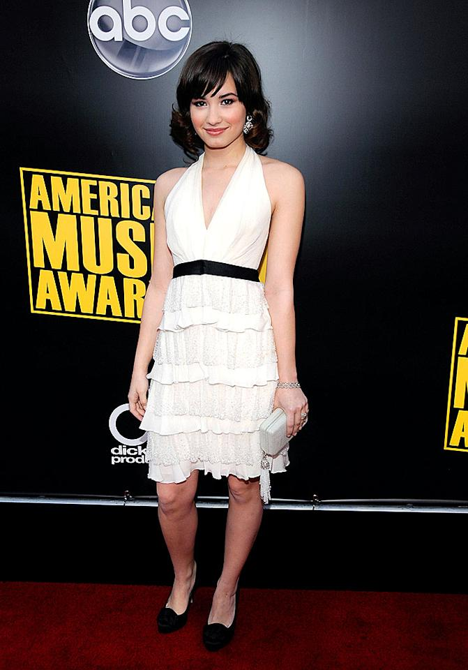 "Demi Lovato once again opted for a look that made her appear much older. She's 16 going on 30! Kevin Mazur/<a href=""http://www.wireimage.com"" target=""new"">WireImage.com</a> - November 23, 2008"
