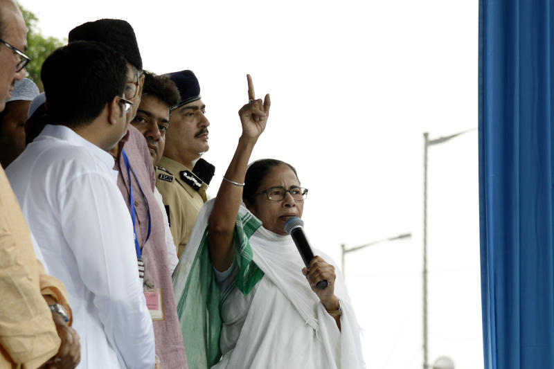 Mamata Banerjee Chief Minister of West Bengal and Supremo of All India Trinamool Congress Political Party address along her nephew Abhishak Banerjee MP ,Javed Khan State Minister and Kolkata Police Commissioner Anuj Sharma Present during the Indian Muslim devotees after prayers Eid al-Fitr at Kolkata Indira Gandhi Sarani on June 05,2019.Muslims around the world are celebrating the Eid al-Fitr festival, which marks the end of the fasting month of Ramadan. (Photo by Debajyoti Chakraborty/NurPhoto via Getty Images)
