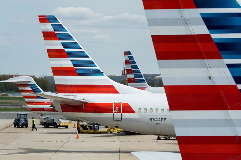 FILE PHOTO: FILE PHOTO: American Airlines planes are parked at the gate during the coronavirus disease (COVID-19) outbreak in Washington