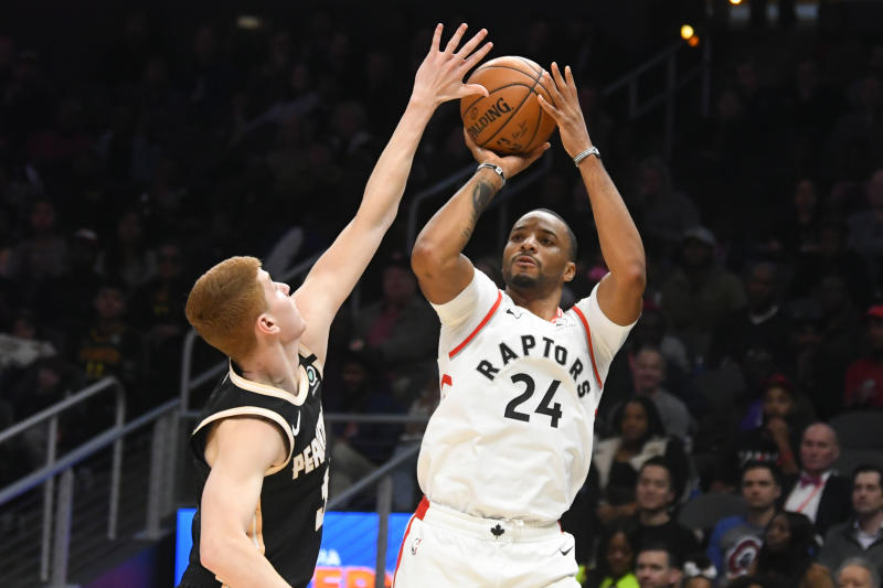 Toronto Raptors guard Norman Powell (24) shoots as Atlanta Hawks guard Kevin Huerter defends during the second half of an NBA basketball game Monday, Jan. 20, 2020, in Atlanta. Toronto won 122-117. (AP Photo/John Amis)
