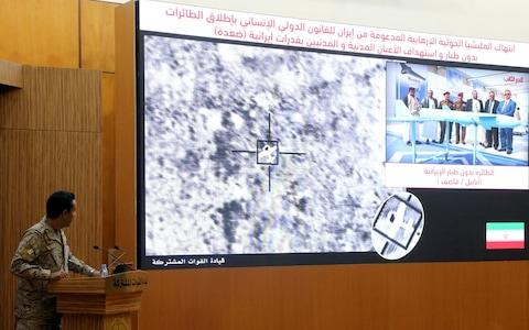 <span>A Saudi spokesperson presents information about the drone attack</span> <span>Credit: REUTERS/ STRINGER </span>