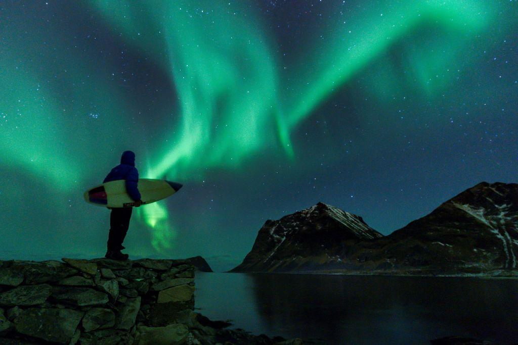 <p>A surfer looks at Northern Lights on March 9, 2018 in Utakleiv, northern Norway, Lofoten islands, within the Arctic Circle. Photo from Olivier Morin/AFP/Getty Images. </p>