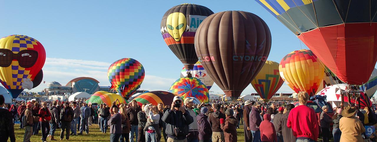 In this Oct. 8, 2011 photo, hot air balloons are shown at the Albuquerque International Balloon Fiesta before take off. The 41st annual event is set to begin Saturday and is expected to draw hundreds of thousands of spectators from around the country and the global. (AP Photo/Russell Contreras)