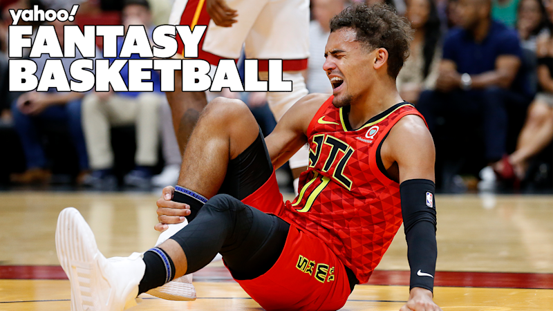 MIAMI, FLORIDA - OCTOBER 29: Trae Young #11 of the Atlanta Hawks is reacts after being injured against the Miami Heat during the first half at American Airlines Arena on October 29, 2019 in Miami, Florida. NOTE TO USER: User expressly acknowledges and agrees that, by downloading and/or using this photograph, user is consenting to the terms and conditions of the Getty Images License Agreement. (Photo by Michael Reaves/Getty Images)