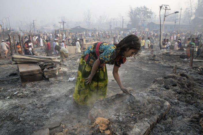 A girl sifts through the ashes on March 23, 2021, two days after a huge fire swept through a Rohingya refugee camp in southern Bangladesh, destroying thousands of homes and killing at least seven people in the worst blaze to hit the settlement in recent years. / Credit: Yousuf Tushar/LightRocket/Getty