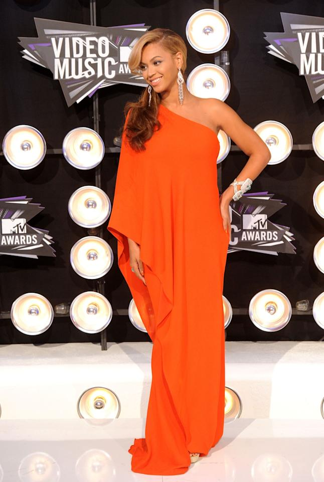 <p>Beyonce showcased her bump for the very first time at the 2011 VMAs, wearing an unmissable draped Lanvin gown. <i>[Photo: Getty]</i> </p>