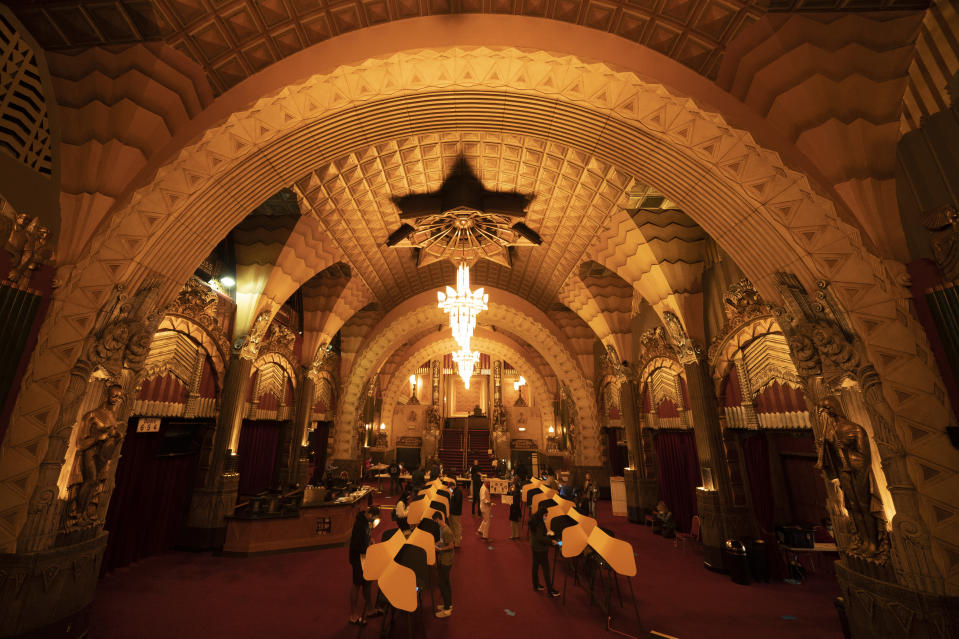 People cast their ballots at a vote center set up at the Hollywood Pantages Theatre on Election Day, Tuesday, Nov. 3, 2020, in Los Angeles. (AP Photo/Jae C. Hong)