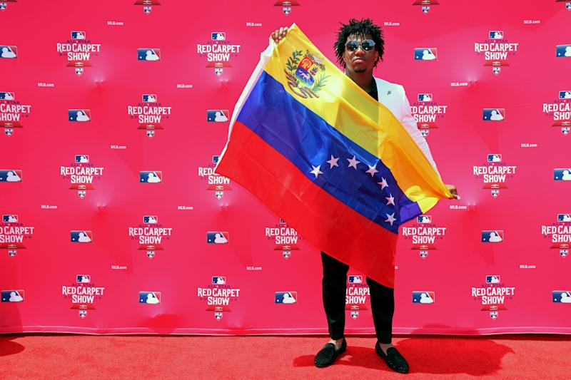 CLEVELAND, OH - JULY 09: Ronald Acuna Jr. #13 of the Atlanta Braves poses for a photo during the MLB Red Carpet Show presented by Chevrolet at Progressive Field on Tuesday, July 9, 2019 in Cleveland, Ohio. (Photo by Adam Glanzman/MLB Photos via Getty Images)